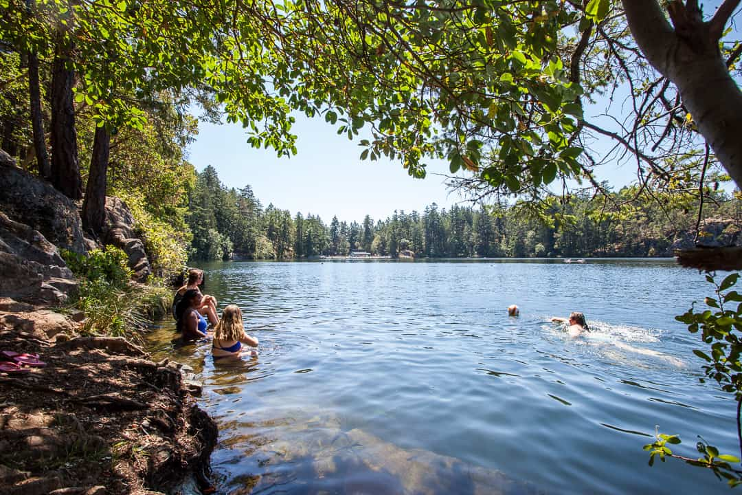 Swimmers at Thetis Lake, Victoria.